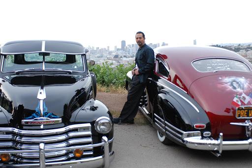 Benjamin Bratt with cars from La Mission